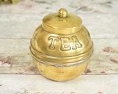 Unusual vintage brass tea caddy or box, spherical with lift off lid, and embossed with the word 'TEA'