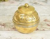 Unusual vintage brass tea...