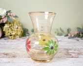 vintage glass vase with gilded stripes and bright flower design, splayed rim