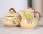 Cream ceramic sugar bowl and creamer set, Wade Bramble design from late 1940's.