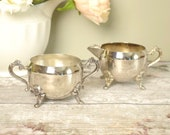 silver metal plate cream jug and sugar bowl, decorative relief embossed Victorian