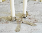 Unusual candlestick holder made from two vintage silver spoons