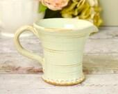 Small vintage milk jug or...