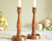 Pair of vintage varnished dark wood wooden candlesticks