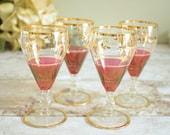Four vintage sherry glass...