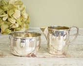 silver metal plate cream jug and sugar bowl, relief embossed Arts and Crafts style