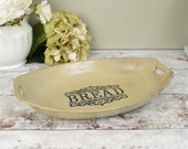 "Vintage stoneware oval bread serving platter, dish or tray, with ""Bread"" text detail"