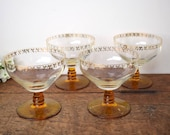 Set of four, retro vintage coupe gilded design dessert glasses from the 1970's.