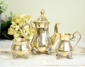 Decorative vintage engraved silver plated coffee pot, sugar bowl and creamer set.