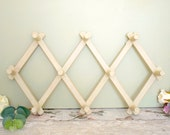 1940's vintage wooden expandable peg rack or hook rack, painted and worn