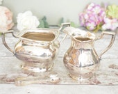 silver EPNS cream jug and sugar bowl, unusual square rim shape, with sugar tongs