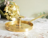 Vintage engraved brass bedside candlestick candle holder or chamber stick, with long 'pan' handle