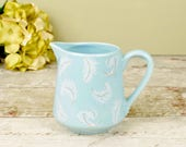 1pt jug or pitcher, aqua ceramic with white feather pattern.