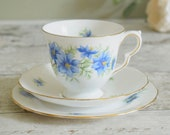 Vintage English bone china trio, cup, saucer and tea plate in gorgeous blue cornflower design