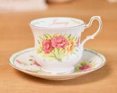 Vintage tea cup and saucer, English bone china- peach, pink and yellow carnations January design.