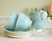 Set of four cups and saucers, teal colour 'Cascade' design by Royal Doulton