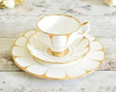 White and gold, cup, saucer and plate trios, white and gold bone china from Royal Vale (England)