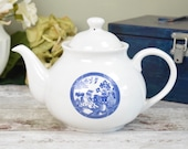 Vintage blue and white willow pattern tea pot