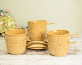 Set of six retro soup bowls or mugs with handles and matching saucers, mustard ochre glazed ceramic