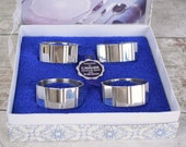 Set of four faceted silve...
