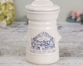 Storage jar or pot with lid, cream ceramic with dark blue illustration and text