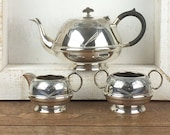 Vintage silver metal plate teapot with bakelite handle, sugar bowl and creamer set