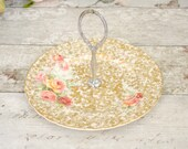 Floral chintz design vintage cake plate with silver metal central carry handle