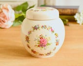 Vintage ginger jar with lid, glazed ceramic with pretty pink floral ring design