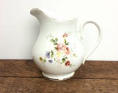 Small milk/cream jug with gilded rim and pretty sprig floral design vintage bone china