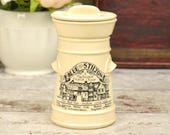 Small storage jar or pot with lid, cream ceramic with black traditional style illustration and text