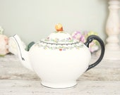 Vintage white spherical tea pot, 1940's black and brights fruit border design, and black glazed handle