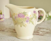 Vintage ceramic jug or pitcher with thistle flower motif on a cream ground, made by Grindley, England