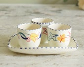 Set of three vintage ceramic egg cups with matching plate or stand, hand painted Poole pottery.