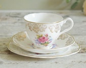 "Vintage English bone china trio, cup, saucer and tea plate in traditional gilded chintz 'Viona"" design"