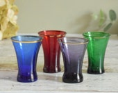 gorgeous coloured glass vintage shot glasses, small tumblers set of four in different jewel colours, multicoloured glasses