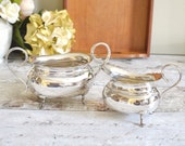 silver metal plate cream jug and oval sugar bowl, with decorative rim