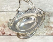 vintage oval trinket or sweet serving basket, decorative silver metal, hinged handle