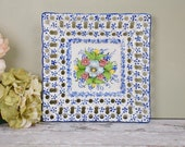 Vintage white and blue Spanish majolica square plate or dish with central floral motif and openwork edge