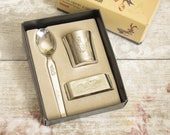 Vintage boxed set of EPNS silver plate child's egg cup, spoon and matching napkin ring, engraved with the name John