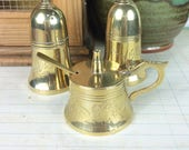 Vintage brass salt shaker, pepper pot and condiment pot with matching spoon, cruet set
