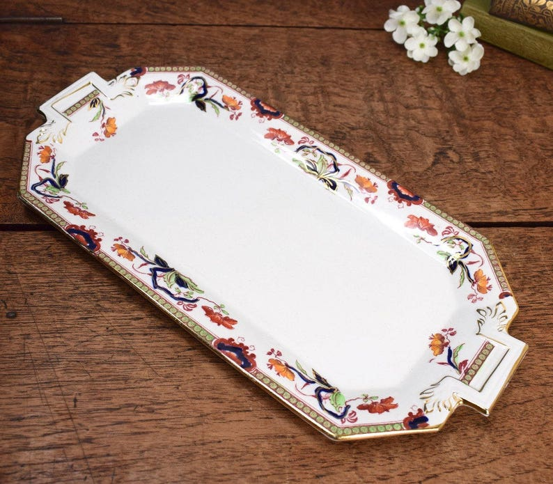 Vintage traditional style ceramic sandwich plate.