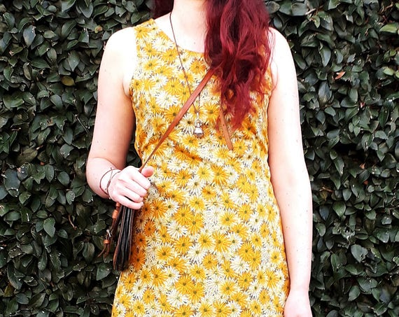 The Frankie tunic dress with waist ties in yellow daisy print