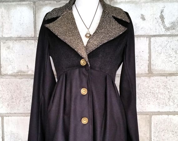 The Ruby Coat, Jacket in Black and Gold with Cinched Waist and Wooden Buttons.