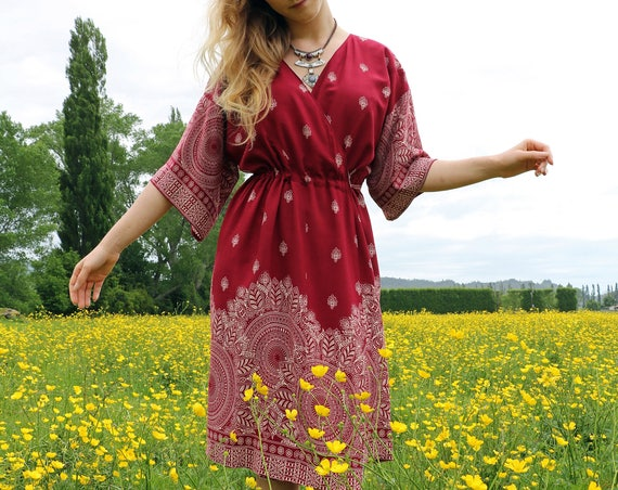 The kimono wrap dress in red boho border print