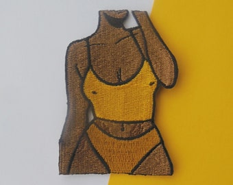 Curvaceous yellow dark skinned embroidered iron-on sew on patch | body positive patch, stretchmarks patch, female form patch