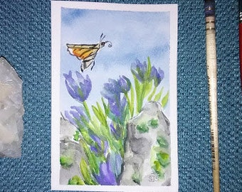 """Original mini watercolor painting of a hummingbird moth with blue violet flowers and rocks - 4x6""""  (10.16 x 15.24 cm) - not a print or copy"""