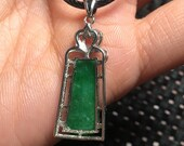 Natural green jadeite inlaid with a stylish and beautiful necklace pendant in 925 silver.
