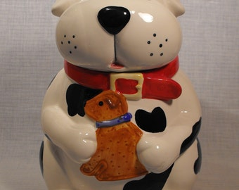 CKA  Ceramic  Dog Style  Cookie Treat Jar Black and White Red Collar Holding Brown Puppy 10 1/2 inches high