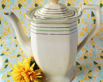 A vintage bone china Titian Ware coffee pot/ tea pot/ chocolate pot by Adams. Iconic art deco green and silver styling. c1920s/ 1930s.