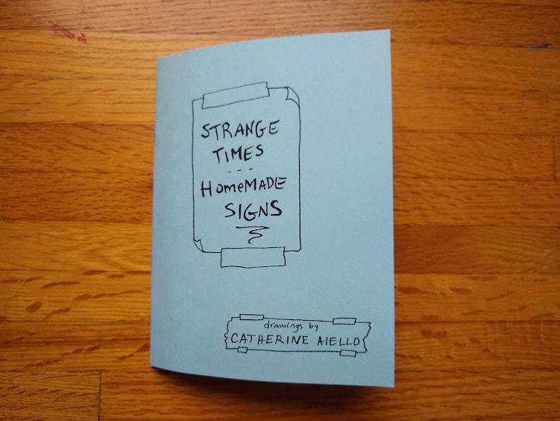 Strange Times Homemade Signs  Zine image 0
